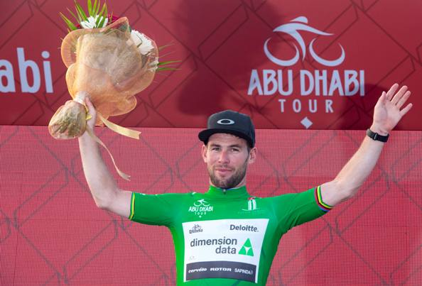 """UK rider Mark Cavendish of Dimension Data Team wearing Green Jersey on the podium of the 115 km """"Nation Towers"""" Second stage of Abu Dhabi cycling race from Abu Dhabi to Abu Dhabi Al Marina, UAE, 21 October 2016. ANSA/CLAUDIO PERI"""