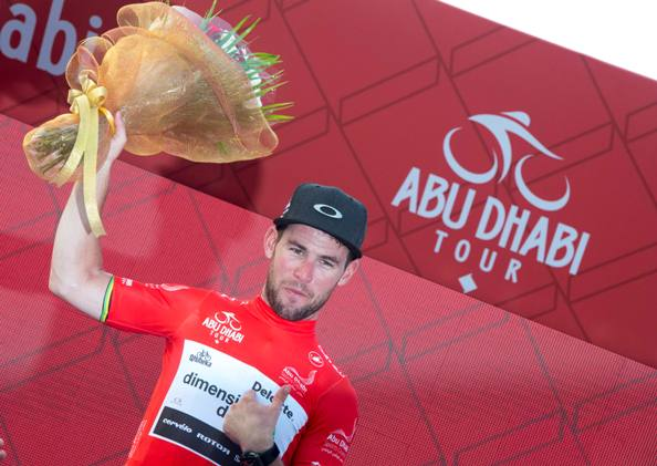 """UK rider Mark Cavendish of Dimension Data Team wearing Red Jersey on the podium of the 115 km """"Nation Towers"""" Second stage of Abu Dhabi cycling race from Abu Dhabi to Abu Dhabi Al Marina, UAE, 21 October 2016. ANSA/CLAUDIO PERI"""